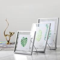 ingrosso cornici galleggianti-Cornice per foto in vetro pressato Cornice per foto in filo metallico nordico con simpatico supporto per cavalletto per gatti Argento oro Nero 4x4 4x6 4x7
