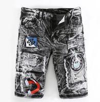 modisch gestickte jeans großhandel-billige kurze jeans männer homme biker jeans männer hochwertige männliche denim hosen Patch gestickte hose Lose gerade modedesigner