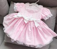 mangas rosa venda por atacado-Crianças roupas de grife Menina Vestido Espanha estilo Verão Estilo Rosa Lace Bow Sopro Manga Design Lolita Vestido de Princesa Menina Roupas Vestido