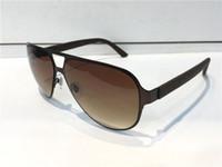 diseñador de gafas de lujo para hombres al por mayor-Diseñador de lujo Gafas de sol para hombre Diseñador de moda Cristal de sol Marco ovalado Revestimiento Espejo UV400 Lente Fibra de carbono Piernas Estilo de verano Gafas