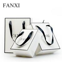 ingrosso confezione regalo riciclata-FANXI 12pcs / lot all'ingrosso maniglia di lusso bianco riciclato borse di imballaggio regalo gioielli stampati con sacchetto di carta shopping nastro di seta