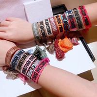 encantos de sapato pulseiras de silicone braceletes venda por atacado-Designer de luxo jóias mulheres homens pulseiras moda trançado borla pulseira 34 estilo de alta qualidade bordado amantes pulseira