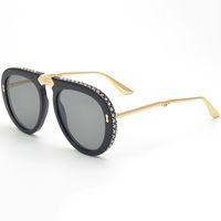 moldura oval pequena venda por atacado-Homens Óculos Oval Quadro Mulheres Dobrável Óculos De Sol Da Marca De Moda Óculos De Sol Com Pequenos Diamantes No Quadro