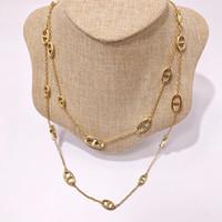 colares pingente de bronze venda por atacado-Nova chegada material de bronze de muitas cores oco pingente camisola colar de nome de marca de jóias para as mulheres presente de casamento gota de Transporte PS5154