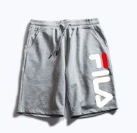 pantalones de moda pantalones al por mayor-Las nuevas mujeres de la playa del ocio pantalones de yoga pantalones de movimiento de la moda parejas casuales pantalones cortos calzones FSS2073