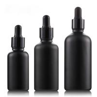 matte livre de óleo venda por atacado-Diretamente do fabricante! 30ml 50ml 100ml garrafas de vidro de óleo Matte Black Scrub Preto Dropper Bottle cigarro eletrônico Bottle Oil Free DHL