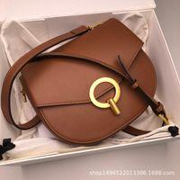 Wholesale saddle color for sale - Group buy Elegant2019 Saddle Button Lock Genuine Leather Woman Niche Small Circle Package Single Shoulder Satchel