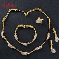 conjunto de anillos de novia corazón al por mayor-Toda la ventaSunny Jewelry Women Bridal Jewelry Set Dubai Wedding Cubic Zirconia Bowknot Heart Collar Pendientes Anillo Pulsera Étnica