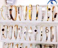 ingrosso rhinestones di formato misto-Braccialetto d'argento in oro rosa titanio bracciale in acciaio con strass progettista dell'annata Formato libero all'ingrosso della miscela Differente