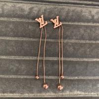 püskül küpeleri toptan satış-En kaliteli ünlü marka 316L Titanyum çelik mektubu uzun püskül bırak Küpe Kadınlar Charm gül altın kızlar Küpe Moda yaz Takı