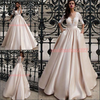 Wholesale plus size wedding brides dresses long online - Trendy Lace Champagne Half Sleeve Wedding Dresses With Pockets Satin A Line Plus Size African robe de mariée Bride Dress Ball Bridal Gowns