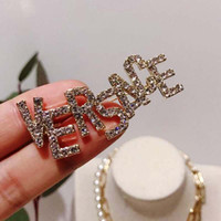 Wholesale gold brooch bling for sale - Group buy New Trendy Brand Letters Badge Brooches Bling Bling Crystal Letters Brooch Pins Women Girl Suit Coat accessories Jewelry