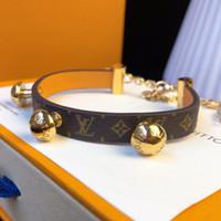 ingrosso gioielli funghi-Nuovi braccialetti di cuoio genuini di modo con tre design del fungo dell'oro per i monili di modo del braccialetto del modello del fiore di lusso superiore delle donne