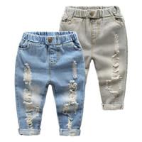 bebé pantalones vaqueros agujeros al por mayor-Niños pantalones vaqueros de pierna recta Little Baby Boys Girl Moda Ripped Western Jeans Pantalones de mezclilla Ripped Holes Jeans Pantalones