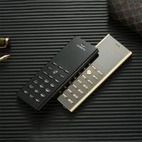 kamera-handy schwarzes gold großhandel-Entsperrt Original Brand V01 Luxus Gold Schwarz Metall Gehäuse Handy Dual Sim Karte Handys Bluetooth FM Mp3 Kamera Handys