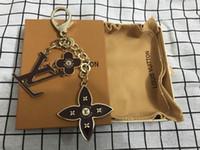 Wholesale new keychain designs resale online - 2019 new brand fashion key chain Alphabet flower design keychain luxury women men Lover Keychains Trinket Jewelry Gift Souvenirs