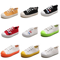 zapatos de lona de los niños de color naranja al por mayor-Zapatos sin marca lona de los niños para Niños Niñas resbalón en los zapatos ocasionales de la galleta de Whtie Negro Rojo Naranja colores del caramelo 20-31 Estilo 1