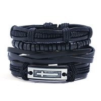 ingrosso braccialetti in pelle nera-4 pezzi / set hippie punk tutti i cinturino in pelle nera croce tag fascino perline di legno nodi di corda wrap largo impilabile braccialetti braccialetti per uomo