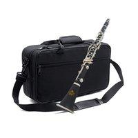 17 clarinete clave al por mayor-WM-228 clarinete tubo negro 17 Llave B plana de baquelita profesión clarinete Instrumento de viento de madera Niños adultos de dos pisos dobles comienzan el shippi libre