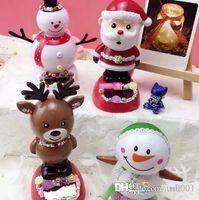 mini mann puppe groihandel-Schönheit US nette Minipuppenkinderspielzeug Christman Deer Schneemann Puppen Solarenergie Schütteln Kopf-Verzierung Spielzeug