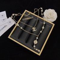 broches femeninos al por mayor-Las mujeres de alta calidad 18K collar de oro natural nano collar de perlas moda suéter largo collar femenino broche casual