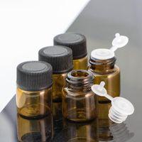 Wholesale essential oils 2ml bottles resale online - Mini Essential Oil Glass Bottles ml ml Empty Amber Bottle Small Glass Vials With Black Cap For Sale