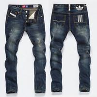 sillones de sarga para hombre al por mayor-Diseñador de moda para hombre Ripped Biker Jeans Patchwork de cuero Slim Fit Moto Denim Joggers para hombres Pantalones vaqueros desgastados