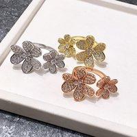 folha de ouro china venda por atacado-18 k banhado a ouro cobre micro pavimentada completa cz pedra três folhas anéis de flores para as mulheres 2019 venda quente nova moda jóias de luxo