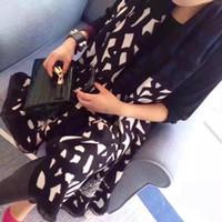 ponchos de tartán al por mayor-La última bufanda de diseño clásico Bufanda de moda para hombres y mujeres Bufanda de algodón suave Bufandas de diseñador de lujo Bufanda Borsetta 180 cm * 65 cm