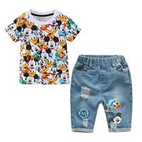 vaqueros de moda para bebés al por mayor-Pantalones cortos de algodón de dibujos animados para niños Pantalones de mezclilla Traje deportivo Bebé Niños Moda Camiseta de manga corta Jeans Conjuntos de ropa 1-5 Y