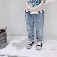 fondos de mezclilla coreana al por mayor-Spring Boys Girls Fashion Jeans agujero roto 2019 estilo coreano Rough Selvedge Casual Denim pantalones niños Bottoms J190517