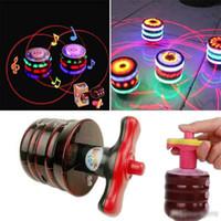 brinquedo levou luzes giroscópio venda por atacado-Música Gyro Peg-Top Spinning Top presente Brinquedo engraçado Toy Crianças clássico UFO giroscópio a laser a cores flash LED Luz de Ano Novo