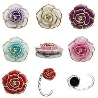 magnetbäder großhandel-Metall Kleiderbügel Rose Form Faltbare Tasche Geldbörse Haken Tragbare Rose Tisch Haken für Tasche Kreative Mehrere Tasche Schreibtisch Kleiderbügel EEA445