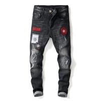 marcas famosas designer jeans venda por atacado-Preto Lavado Designer de Moda Homens Buraco Bordado Calça Jeans de Alta Qualidade Famosa Marca Em Linha Reta Angustiado Rasgado Jeans Rasgado Para Homens