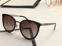 metal çerçeveler takılar toptan satış-Yeni Moda Tasarımcısı Güneş 0077 metal çerçeve bayan popüler kedi göz gözlük ile en kaliteli büyüleyici stil UV400 marka gözlük Paketi