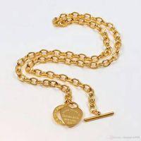hebilla de titanio al por mayor-Corazón de acero titanium collar colgante para las mujeres de San Valentín OT hebilla pulsera accesorios