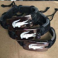 braceletes de amizade couro feminino venda por atacado-Personalizado Do Punk Preto Handmade Corda Weave Das Mulheres Dos Homens Pulseiras De Couro marca Homens Casuais Jóias meninos meninas amizade verão presente de Natal