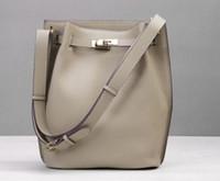 The new first layer leather bag leisure shoulder vertical bucket original leather horseshoe handbag women's single shoulder bag