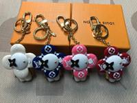 Wholesale dolls package resale online - Designer Fashion Accessories Limited Edition Sun Flower Doll Keychain Bag Decoration Car Key men women Full Premium Gift Box Packaging