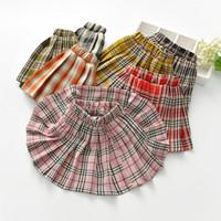 faldas a cuadros coreanos al por mayor-Venta al por menor de lujo de diseño niños muchachas de la ropa de la tela escocesa plisada falda de la moda coreana de la universidad una línea corta tutú faldas ropa de los niños Boutique
