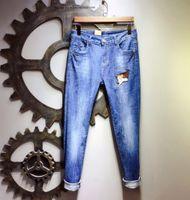 nagel verzieren großhandel-High Street Man Locomotive Herren Designer Jeans Black Hole Willow Nail Schmücken Slim Trousers Male