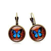 değerli taş kelebek toptan satış-Moda zarif patlama küpe Vintage kelebek zaman taş küpe yaratıcı Fransız kulak kanca Yaratıcı takı toptan