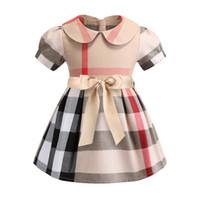 neue kleider mädchen revers großhandel-2019 Mädchen Kleid Frühling und Sommer Neue Baumwollkleidung Revers Kurzarm Plaid Rock Kinder Kleid