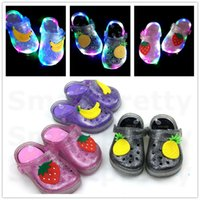 Wholesale jelly glow resale online - INS Girls Jelly Fruit Strawberry Banana LED Light Slippers Summer Kids Non slip Hole Glowing Beach Sandals Princess Shoes size E31010