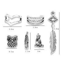 vintage-manschetten-set groihandel-Ohrstulpe Einfache Europäische Und Amerikanische Vintage Eule Croix Blatt Kreis Ohrringe Ohrclip Sieben Stück Pro Set 2019 Großhandel