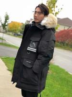 weiße mäntel großhandel-Herren Parkas WINTER CANADA SNOW MANTRA-5 GOOSE Daunenparkas MIT HOOD / Snowdome-Jacke Real Raccoon Collar White Duck Outerwear Mäntel