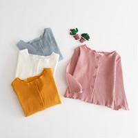 ingrosso maglione giallo di cardigan delle ragazze-New Baby Candy Colore maglia Maglione lavorato a maglia Cardigan Bottone Giacca Capispalla Bambini Bianco Giallo Rosa Colore bianco Vestiti