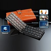 Wholesale Promotional metal folding wireless keyboard can be remotely controlled to take light and easy to carry for IOS Android a