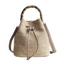 bolso de lazo de verano al por mayor-Nuevo cordón de las mujeres del cubo de paja bolsa de verano tejida bolsas de hombro bolso de compras bolso de playa bolsos de paja bolso de viaje bolso de mano