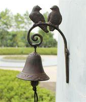 décor d'oiseaux d'amour achat en gros de-Cast Iron Dinner Bell Love Birds Distressed Brown Sonnette extérieur Porche Décor Antique style heurtoir Bienvenue Dinner Bell Ornement Vintage